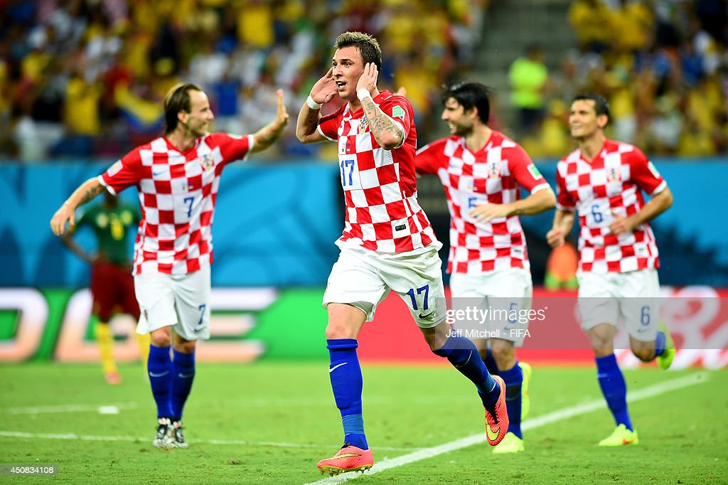 <a gi-track='captionPersonalityLinkClicked' href=/galleries/search?phrase=Mario+Mandzukic&family=editorial&specificpeople=4476149 ng-click='$event.stopPropagation()'>Mario Mandzukic</a> of Croatia celebrates scoring his team's third goal during the 2014 FIFA World Cup Brazil Group A match between Cameroon and Croatia at Arena Amazonia on June 18, 2014 in Manaus, Brazil.