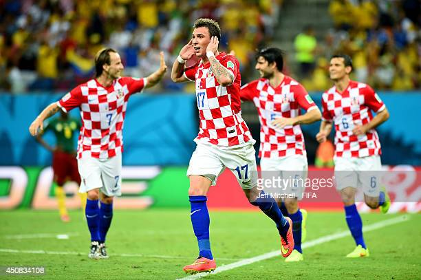 Mario Mandzukic of Croatia celebrates scoring his team's third goal during the 2014 FIFA World Cup Brazil Group A match between Cameroon and Croatia...