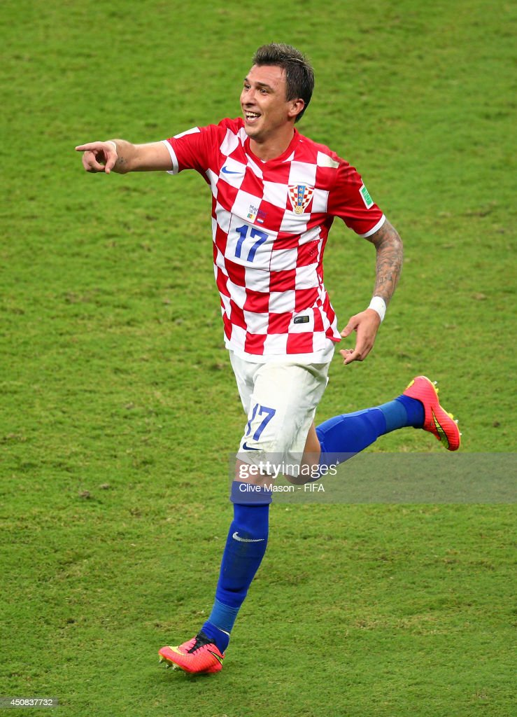 Mario Mandzukic of Croatia celebrates scoring his team's third goal during the 2014 FIFA World Cup Brazil Group A match between Cameroon and Croatia at Arena Amazonia on June 18, 2014 in Manaus, Brazil.