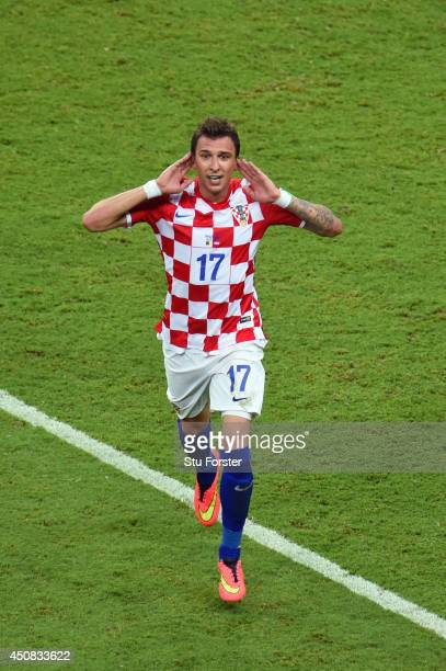 Mario Mandzukic of Croatia celebrates scoring the third goal during the 2014 FIFA World Cup Brazil Group A match between Cameroon and Croatia at...