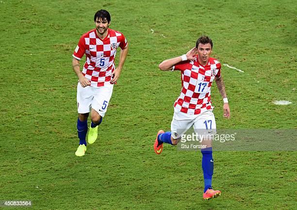 Mario Mandzukic of Croatia celebrates scoring the third goalduring the 2014 FIFA World Cup Brazil Group A match between Cameroon and Croatia at Arena...
