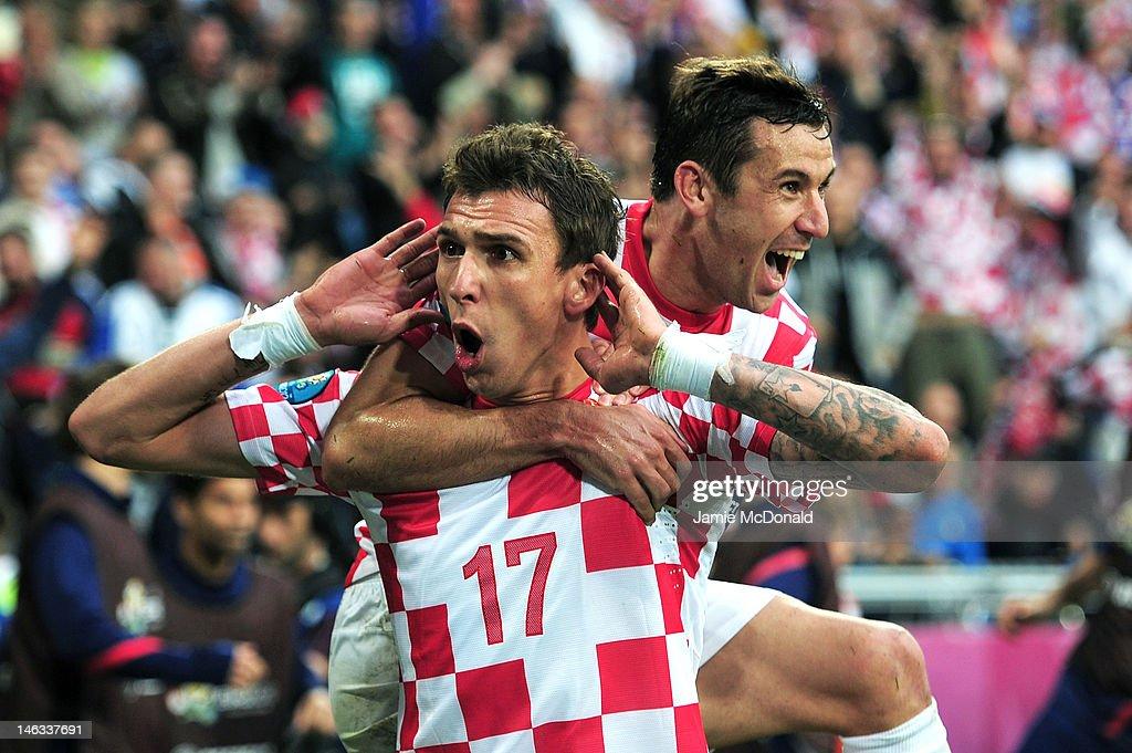 Mario Mandzukic of Croatia celebrates scoring their first goal with Darijo Srna of Croatia during the UEFA EURO 2012 group C match between Italy and Croatia at The Municipal Stadium on June 14, 2012 in Poznan, Poland.