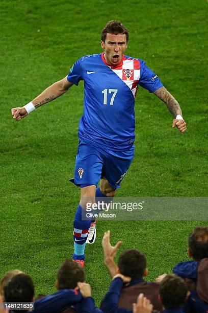 Mario Mandzukic of Croatia celebrates scoring their third goal during the UEFA EURO 2012 group C between Ireland and Croatia at The Municipal Stadium...