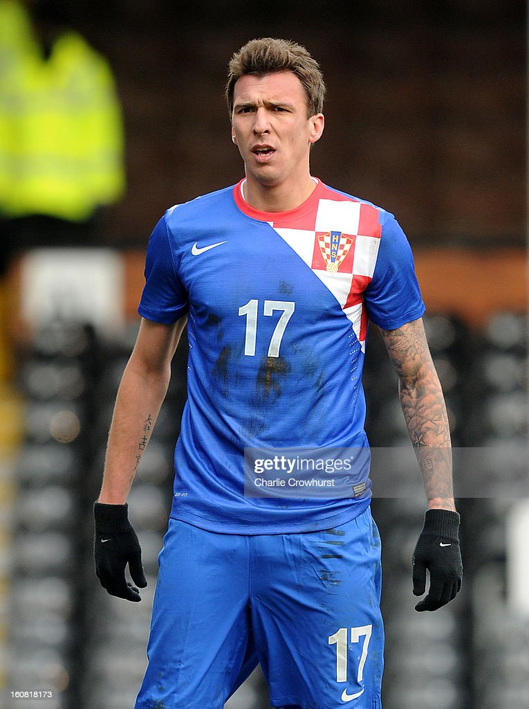 <a gi-track='captionPersonalityLinkClicked' href=/galleries/search?phrase=Mario+Mandzukic&family=editorial&specificpeople=4476149 ng-click='$event.stopPropagation()'>Mario Mandzukic</a> of Croatia during the International Friendly match between Croatia and Korea Republic at Craven Cottage on February 6, 2013 in London, England.