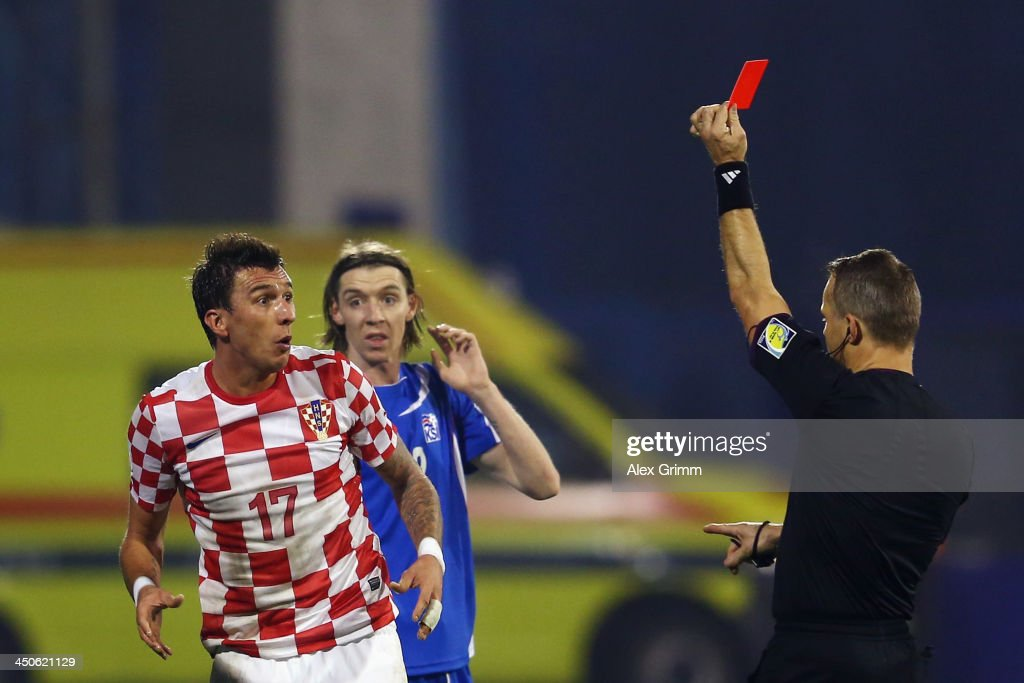 <a gi-track='captionPersonalityLinkClicked' href=/galleries/search?phrase=Mario+Mandzukic&family=editorial&specificpeople=4476149 ng-click='$event.stopPropagation()'>Mario Mandzukic</a> #17 of Croatia reacts after referee <a gi-track='captionPersonalityLinkClicked' href=/galleries/search?phrase=Bjoern+Kuipers&family=editorial&specificpeople=6529217 ng-click='$event.stopPropagation()'>Bjoern Kuipers</a> shows him the red card during the FIFA 2014 World Cup Qualifier play-off second leg match between Croatia and Iceland at Maksimir Stadium on November 19, 2013 in Zagreb, Croatia.