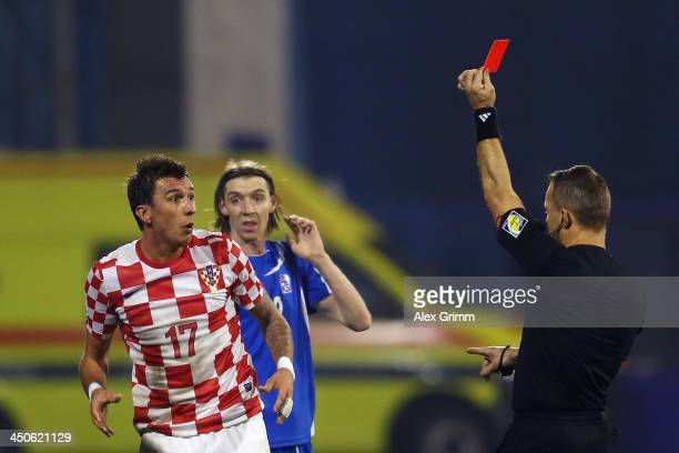 Mario Mandzukic of Croatia reacts after referee Bjoern Kuipers shows him the red card during the FIFA 2014 World Cup Qualifier playoff second leg...