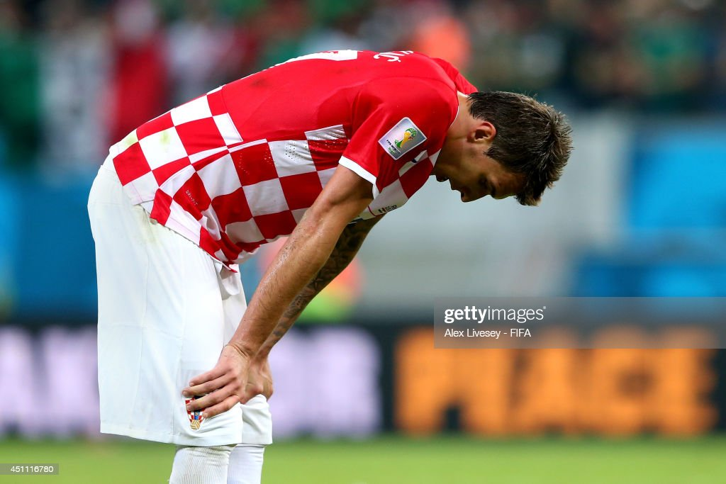 <a gi-track='captionPersonalityLinkClicked' href=/galleries/search?phrase=Mario+Mandzukic&family=editorial&specificpeople=4476149 ng-click='$event.stopPropagation()'>Mario Mandzukic</a> of Croatia reacts after the 1-3 defeat in the 2014 FIFA World Cup Brazil Group A match between Croatia and Mexico at Arena Pernambuco on June 23, 2014 in Recife, Brazil.