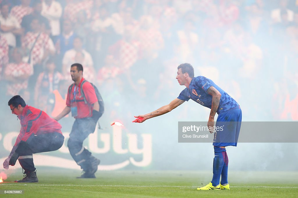 <a gi-track='captionPersonalityLinkClicked' href=/galleries/search?phrase=Mario+Mandzukic&family=editorial&specificpeople=4476149 ng-click='$event.stopPropagation()'>Mario Mandzukic</a> of Croatia reacts as flares are thrown onto the picth during the UEFA EURO 2016 Group D match between Czech Republic and Croatia at Stade Geoffroy-Guichard on June 17, 2016 in Saint-Etienne, France.