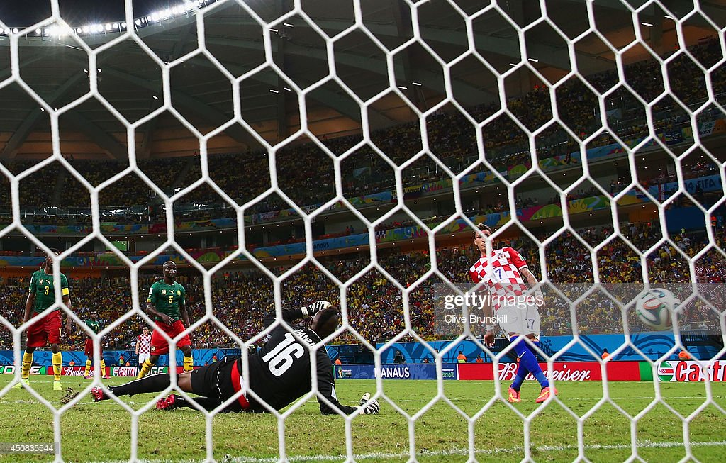 <a gi-track='captionPersonalityLinkClicked' href=/galleries/search?phrase=Mario+Mandzukic&family=editorial&specificpeople=4476149 ng-click='$event.stopPropagation()'>Mario Mandzukic</a> of Croatia scores his team's fourth goal, his second, past <a gi-track='captionPersonalityLinkClicked' href=/galleries/search?phrase=Charles+Itandje&family=editorial&specificpeople=889524 ng-click='$event.stopPropagation()'>Charles Itandje</a> of Cameroon during the 2014 FIFA World Cup Brazil Group A match between Cameroon and Croatia at Arena Amazonia on June 18, 2014 in Manaus, Brazil.