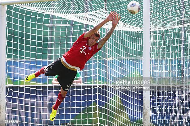 Mario Mandzukic of FC Bayern Muenchen jokes as a goal keeper after a training session at Campo Sportivo on July 9 2013 in Arco Italy