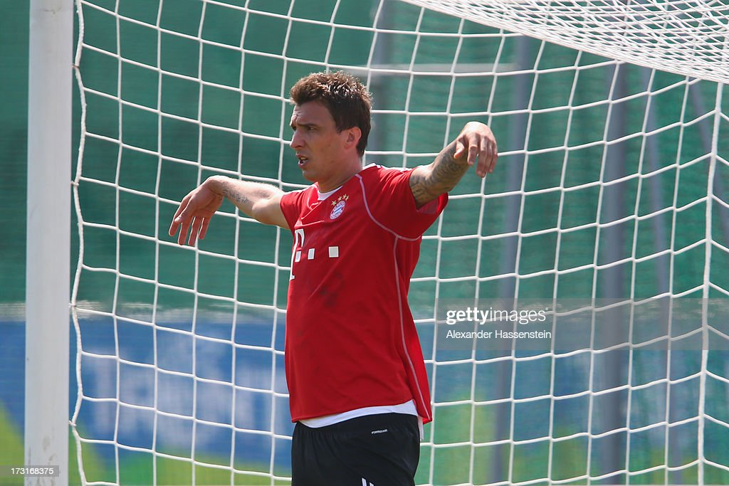 Mario Mandzukic of FC Bayern Muenchen jokes as a goal keeper after a training session at Campo Sportivo on July 9, 2013 in Arco, Italy.
