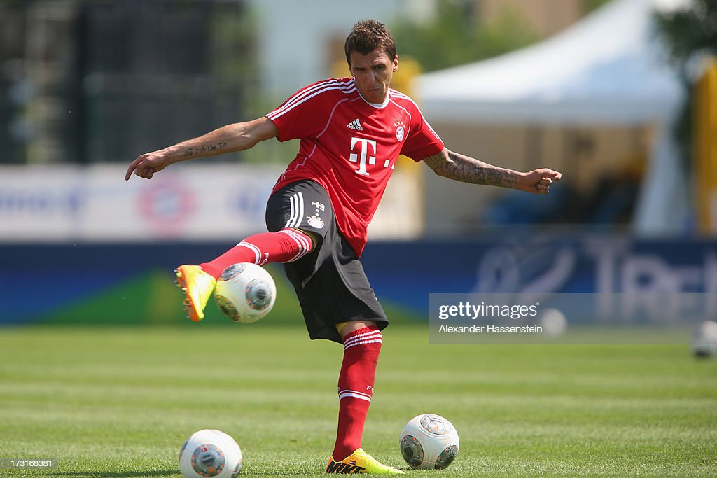 Mario Mandzukic of FC Bayern Muenchen plays the ball after a training session at Campo Sportivo on July 9, 2013 in Arco, Italy.