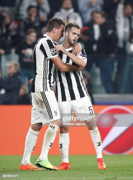 Mario Mandzukic of FC Juventus celebrates his goal with his teammate Miralem Pjanic during the UEFA Champions League group D football match between...