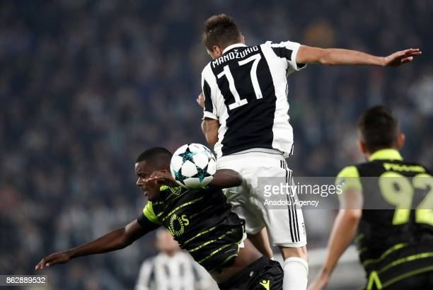 Mario Mandzukic of FC Juventus in action against William Carvalho of Sporting SP during the UEFA Champions League group D football match between FC...