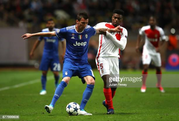 Mario Mandzukic of Juventus and Jemerson of AS Monaco in action during the UEFA Champions League Semi Final first leg match between AS Monaco v...