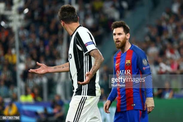 Mario Mandzukic of Juventus and Lionel Messi of FC Barcelona during the UEFA Champions League Quarter Final first leg match between Juventus and FC...