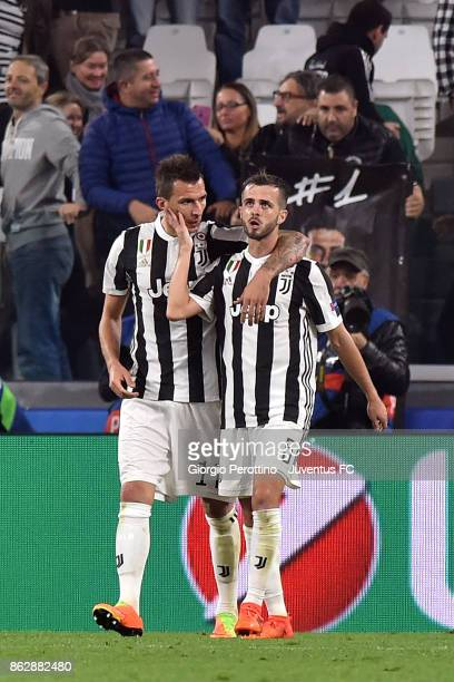 Mario Mandzukic of Juventus celebrates his goal with Miralem Pjanic during the UEFA Champions League group D match between Juventus and Sporting CP...