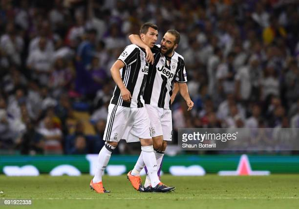Mario Mandzukic of Juventus celebrates scoring his sides first goal with Gonzalo Higuain of Juventus during the UEFA Champions League Final between...