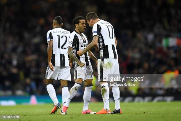 Mario Mandzukic of Juventus celebrates scoring his sides first goal with teammate Dani Alves of Juventus during the UEFA Champions League Final...