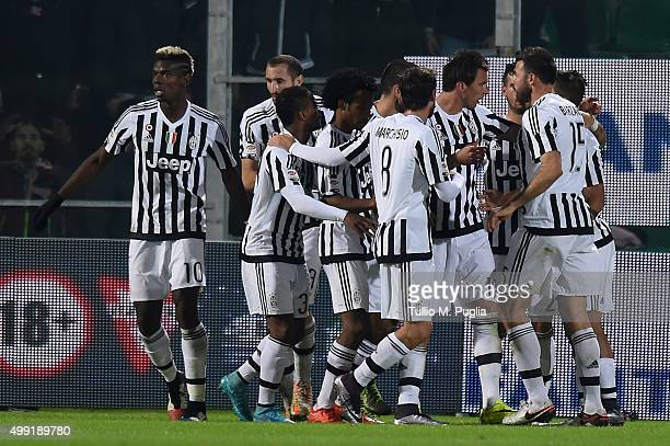 Mario Mandzukic of Juventus celebrates with team mates after scoring the opening goal during the Serie A match between US Citta di Palermo and...