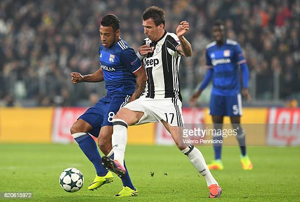 Mario Mandzukic of Juventus competes with Corentin Tolisso of Olympique Lyonnais during the UEFA Champions League Group H match between Juventus and...