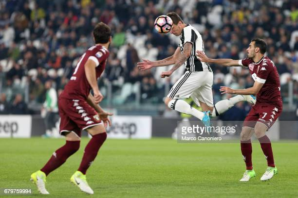 Mario Mandzukic of Juventus FC and Davide Zappacosta of Torino Fc in action during the Serie A football match between Juventus FC and Torino Fc