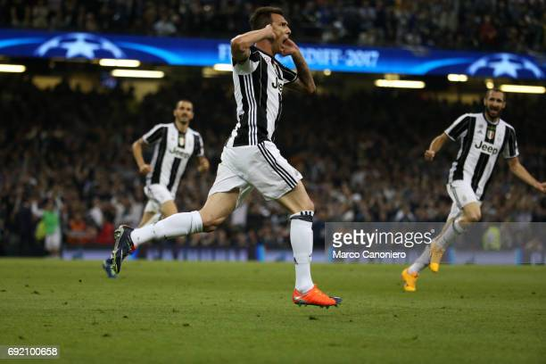 Mario Mandzukic of Juventus FC celebrate after scoring a goal during the UEFA Champions League final match between Juventus FC and Real Madrid CF...