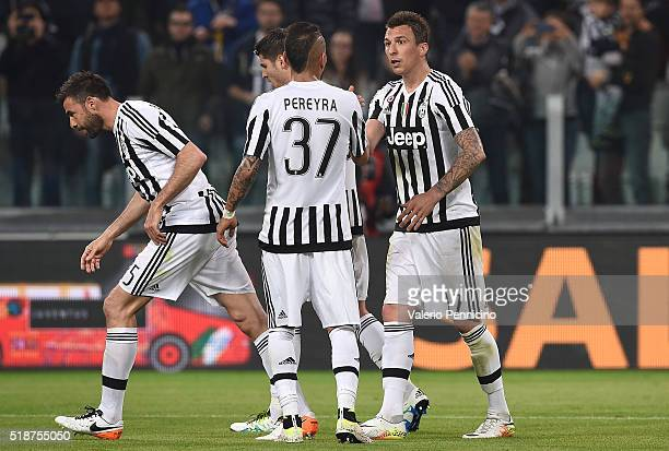 Mario Mandzukic of Juventus FC celebrates after scoring the opening goal with team mate Roberto Maximilian Pereyra during the Serie A match between...