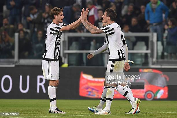 Mario Mandzukic of Juventus FC celebrates after scoring the opening goal with team mate Daniele Rugani during the Serie A match between Juventus FC...
