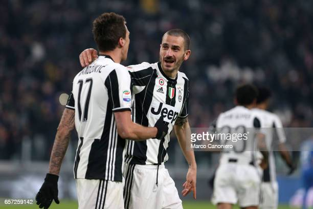 Mario Mandzukic of Juventus FC celebrates after scoring the opening goal with team mate Leonardo Bonucci during the Serie A match between Juventus FC...