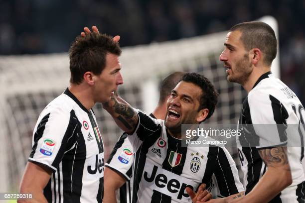 Mario Mandzukic of Juventus FC celebrates after scoring the opening goal with team mates Daniel Alves and Leonardo Bonucci during the Serie A match...