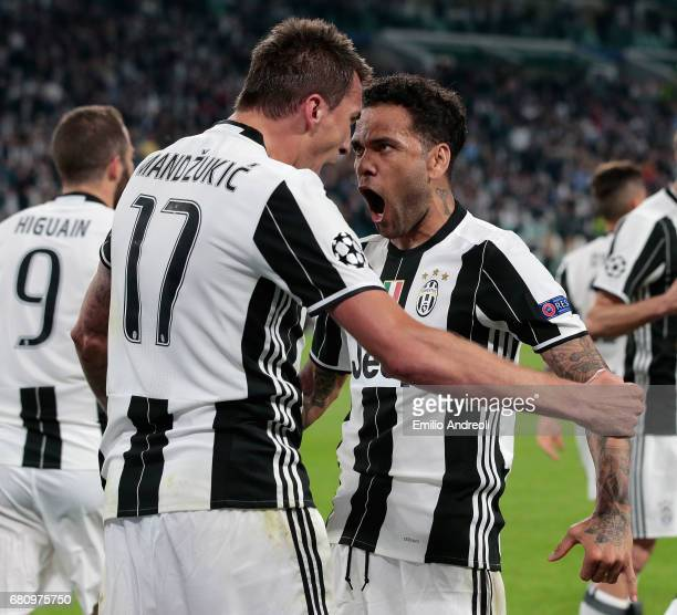 Mario Mandzukic of Juventus FC celebrates with his teammate Daniel Alves da Silva after scoring the opening goal during the UEFA Champions League...