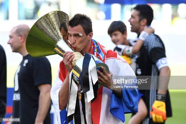 Mario Mandzukic of Juventus FC celebrates with the trophy after beating FC Crotone 30 to win the Serie A Championships at the end of the Serie A...
