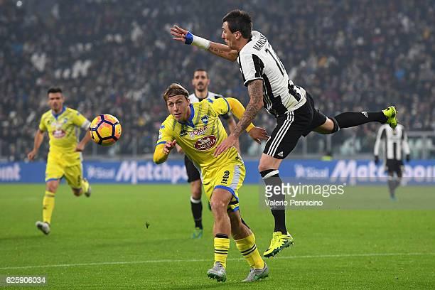 Mario Mandzukic of Juventus FC clashes with Alessandro Crescenzi of Pescara Calcio during the Serie A match between Juventus FC and Pescara Calcio at...