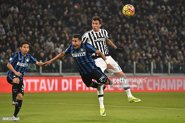 Mario Mandzukic of Juventus FC clashes with Jeison Murillo of FC Internazionale Milano during the TIM Cup match between Juventus FC and FC...