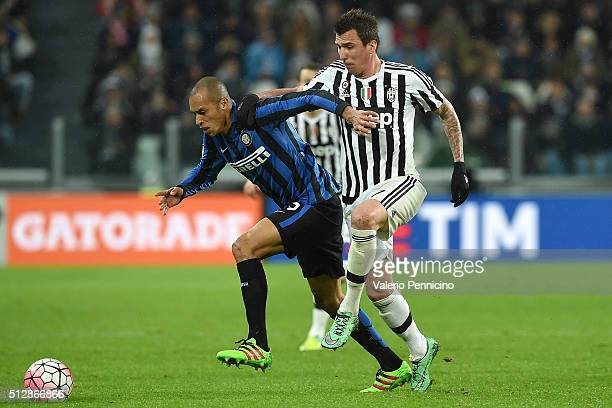 Mario Mandzukic of Juventus FC competes with Joao Miranda of FC Internazionale Milano during the Serie A match between Juventus FC and FC...