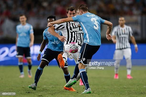 Mario Mandzukic of Juventus FC contests the ball against Stefan De Vrij of Lazio during the Italian Super Cup final football match between Juventus...