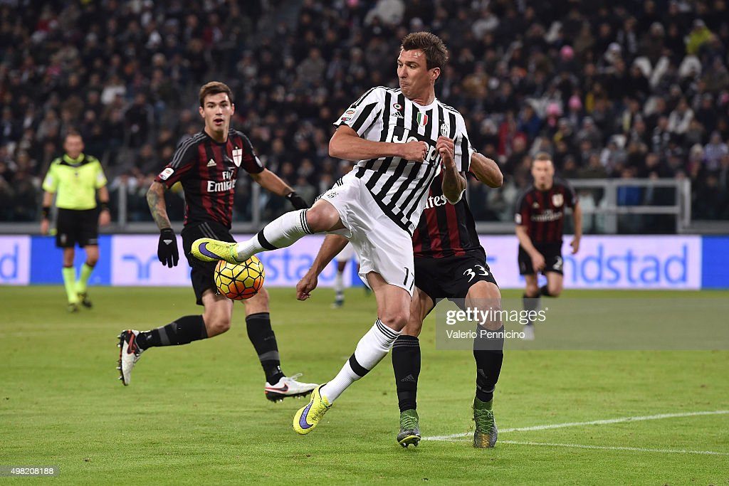 Mario Mandzukic of Juventus FC in action against Alex of AC Milan during the Serie A match between Juventus FC and AC Milan at Juventus Arena on November 21, 2015 in Turin, Italy.