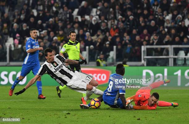 Mario Mandzukic of Juventus FC is challenged by Assane Diousse and Lukasz Skorupski of Empoli FC during the Serie A match between Juventus FC and...