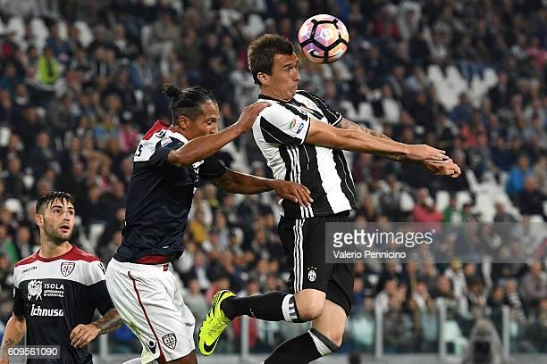 Mario Mandzukic of Juventus FC is challenged by Bruno Alves of Cagliari Calcio during the Serie A match between Juventus FC and Cagliari Calcio at...