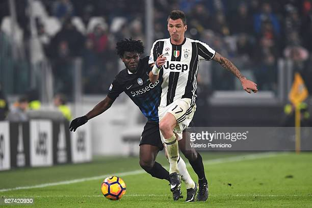 Mario Mandzukic of Juventus FC is challenged by Franck Kessie of Atalanta BC during the Serie A match between Juventus FC and Atalanta BC at Juventus...