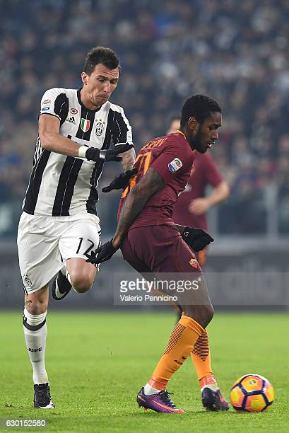 Mario Mandzukic of Juventus FC is challenged by Gerson of AS Roma during the Serie A match between Juventus FC and AS Roma at Juventus Stadium on...