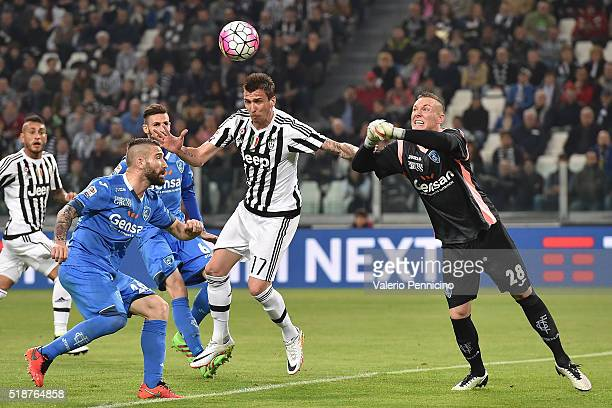 Mario Mandzukic of Juventus FC is challenged by Lukasz Skorupski of Empoli FC during the Serie A match between Juventus FC and Empoli FC at Juventus...