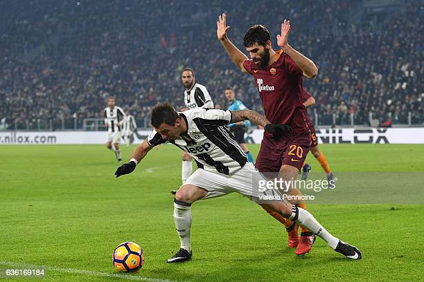Mario Mandzukic of Juventus FC is tackled by Federico Fazio of AS Roma during the Serie A match between Juventus FC and AS Roma at Juventus Stadium...