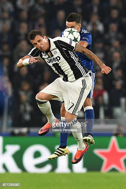 Mario Mandzukic of Juventus goes up with Emanuel Mammana of Olympique Lyonnais during the UEFA Champions League Group H match between Juventus and...