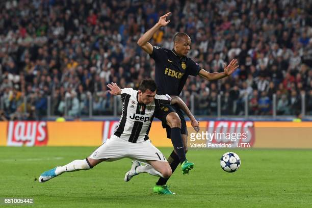 Mario Mandzukic of Juventus is tackled by Fabinho of AS Monaco during the UEFA Champions League Semi Final second leg match between Juventus and AS...