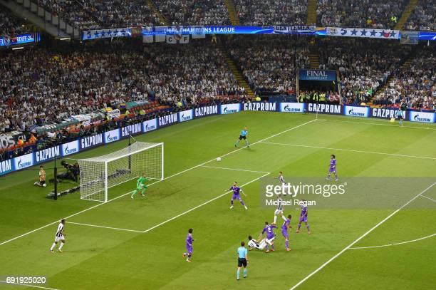 Mario Mandzukic of Juventus scores his sides first goal during the UEFA Champions League Final between Juventus and Real Madrid at National Stadium...