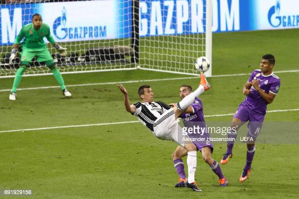 Mario Mandzukic of Juventus scores his sides first goal during the UEFA Champions League Final between Juventus and Real Madrid at National Stadium...