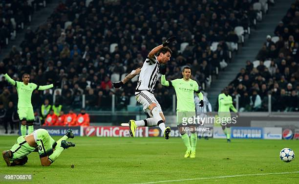 Mario Mandzukic of Juventus scores the opening goal during the UEFA Champions League group D match between Juventus and Manchester City FC at the...