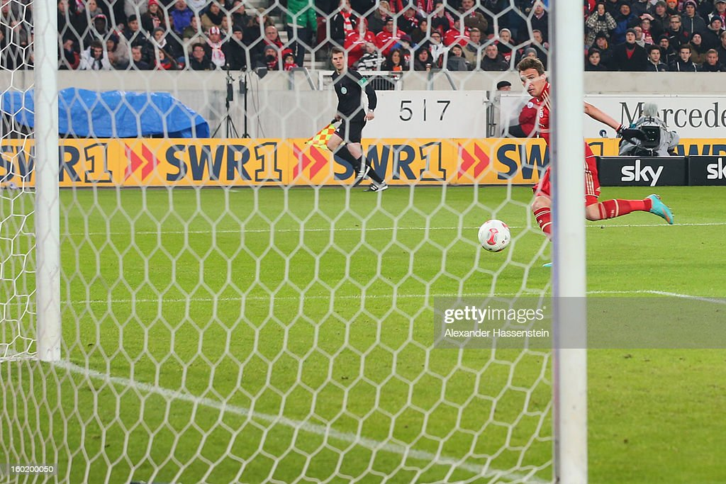 Mario Mandzukic of Muenchen battles scores the opening goal during the Bundesliga match between VfB Stuttgart and FC Bayern Muenchen at Mercedes-Benz Arena on January 27, 2013 in Stuttgart, Germany.